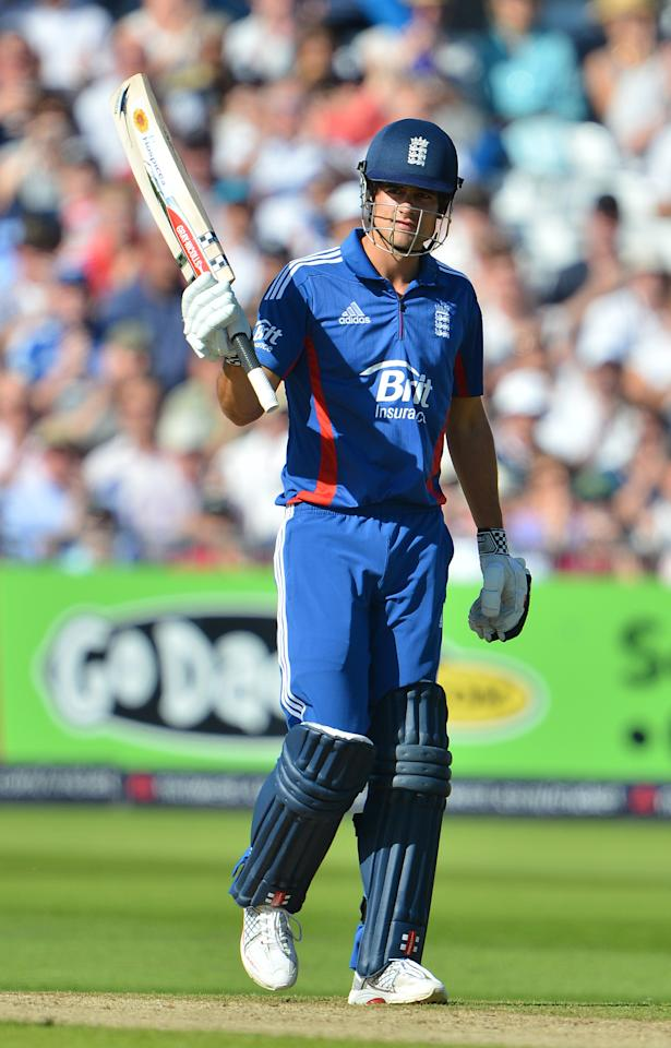 England's Alastair Cook celebrates reaching 50 runs during the fourth one day international cricket match between England and South Africa at Trent Bridge in Nottingham, central England, on September 5, 2012. AFP PHOTO/ANDREW YATES     RESTRICTED TO EDITORIAL USE. NO ASSOCIATION WITH DIRECT COMPETITOR OF SPONSOR, PARTNER, OR SUPPLIER OF THE ECB        (Photo credit should read ANDREW YATES/AFP/GettyImages)