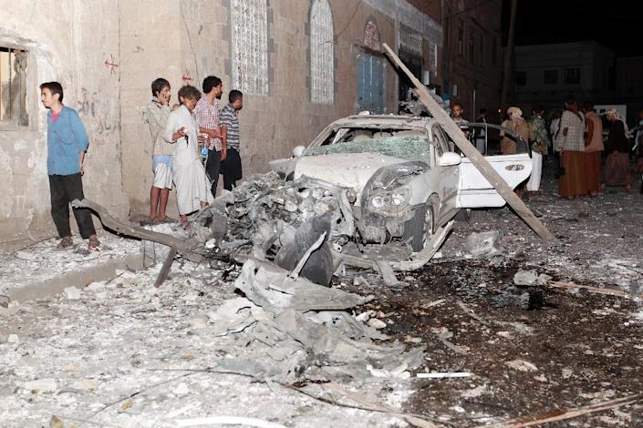 The wreckage of a car is seen at the site of a car bomb attack in the capital Sanaa on June 29, 2015 (AFP Photo/Mohammed Huwais)