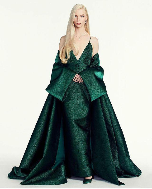 """<p>The Queen's Gambit star wore a custom-made emerald green Dior plunging gown and coat with Tiffany & Co jewellery to the <a href=""""https://www.elle.com/uk/fashion/g25746956/golden-globes-best-red-carpet-looks/"""" rel=""""nofollow noopener"""" target=""""_blank"""" data-ylk=""""slk:2021 Golden Globes"""" class=""""link rapid-noclick-resp"""">2021 Golden Globes</a>.</p><p><a href=""""https://www.instagram.com/p/CL3O604HBDB/"""" rel=""""nofollow noopener"""" target=""""_blank"""" data-ylk=""""slk:See the original post on Instagram"""" class=""""link rapid-noclick-resp"""">See the original post on Instagram</a></p>"""
