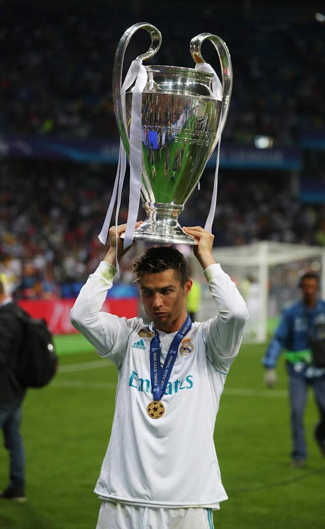Soccer Football - Champions League Final - Real Madrid v Liverpool - NSC Olympic Stadium, Kiev, Ukraine - May 26, 2018 Real Madrid's Cristiano Ronaldo celebrates winning the Champions League with the trophy REUTERS/Hannah McKay