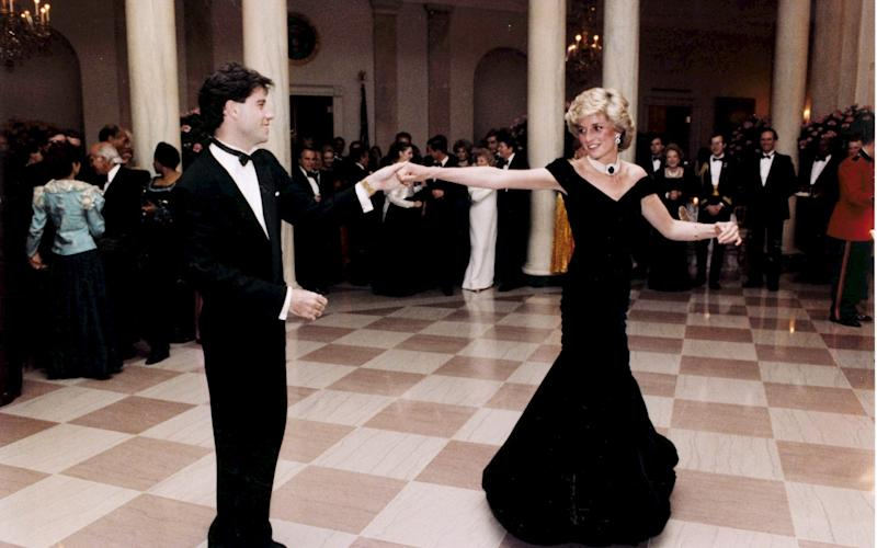 Dianawore the dress when she danced with John Travolta at a 1985 state banquet at the White House - EPA