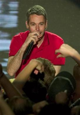 "Adam Yauch of The Beastie Boys leans into the crowd as he performs during MTV2's ""2$Bill"" concert series at the Huntridge Theatre in Las Vegas, June 9, 2004."