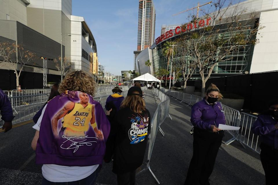 Fans line up at Staples Center to enter the arena. Attendance is limited to 2,000 for the Lakers-Celtics game on Thursday.