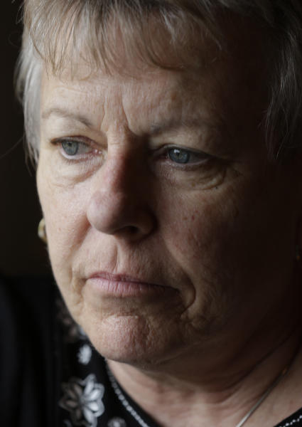 This Tuesday, Feb. 12, 2013 photo shows Sister Carol Gray at her home in Tuscaloosa, Ala. At 23, Carol bottomed out when she tried to kill herself. She would find herself drawn to religion. Twice she went through the application process for Catholic religious orders and twice the community cited her father's drinking and mental illness as reasons to reject her. After her second rejection, she cried herself to sleep. Then a nun named Sister Faith urged her to give it one more try. She did, and her acceptance led her to Maryland, West Virginia, Massachusetts, Mississippi and, finally, Tuscaloosa, Ala., where she now serves as regional director for Catholic Social Services of West Alabama. (AP Photo/Dave Martin)