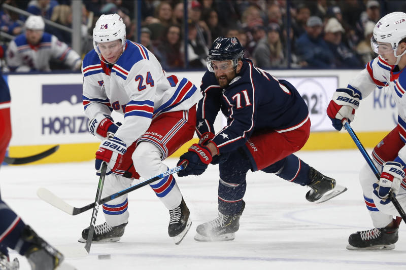 New York Rangers' Kaapo Kakko, left, of Finland, and Columbus Blue Jackets' Nick Foligno vie for the puck during the first period of an NHL hockey game Friday, Feb. 14, 2020, in Columbus, Ohio. (AP Photo/Jay LaPrete)