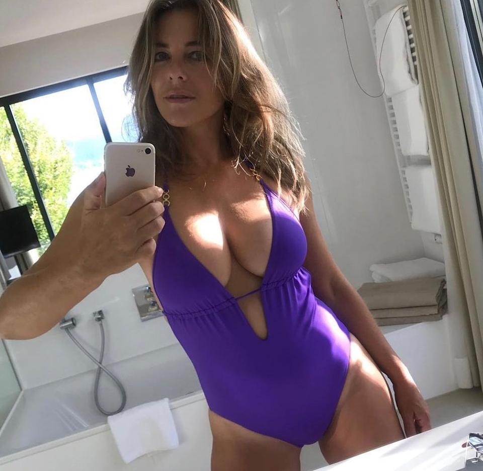 Elizabeth Hurley takes a selfie in a purple swimsuit