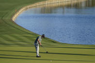 Brian Harman putts on the 18thth hole during the first round of the The Players Championship golf tournament Thursday, March 11, 2021, in Ponte Vedra Beach, Fla. (AP Photo/John Raoux)