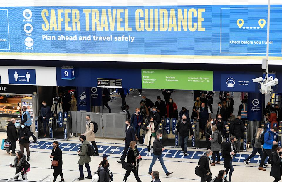 <p>People travel through Waterloo railway station during the morning rush hour</p> (REUTERS)