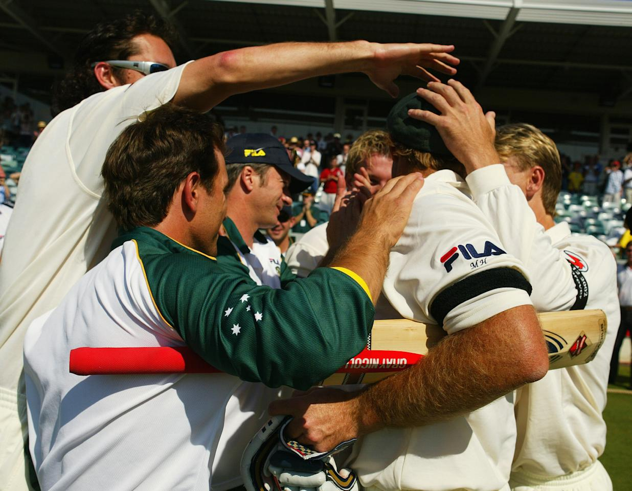 PERTH, AUSTRALIA - OCTOBER 10:  Matthew Hayden of Australia is congratulated by team mates after breaking Brian Lara of The West Indies world record of 375 during day two of the First Test between Australia and Zimbabwe played at the WACA Ground on October 10, 2003 in Perth, Australia. (Photo by Hamish Blair/Getty Images)