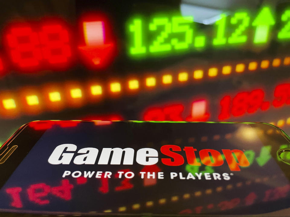 Photo by: STRF/STAR MAX/IPx 2021 1/29/21 Dow drops more than 600 points today to finish the worst week since October 2020 amidst the trading frenzy with GameStop, AMC and other stocks. Robinhood has come under intense scrutiny as it is now limiting trades on more than 50 stocks. Trading platforms such as STASH have issued statements favoring long term over short term trading. Platforms have struggled to keep up with the volume of trades being executed. STAR MAX Photo: An Gamestop logo and stock ticker symbols photographed off Apple devices.