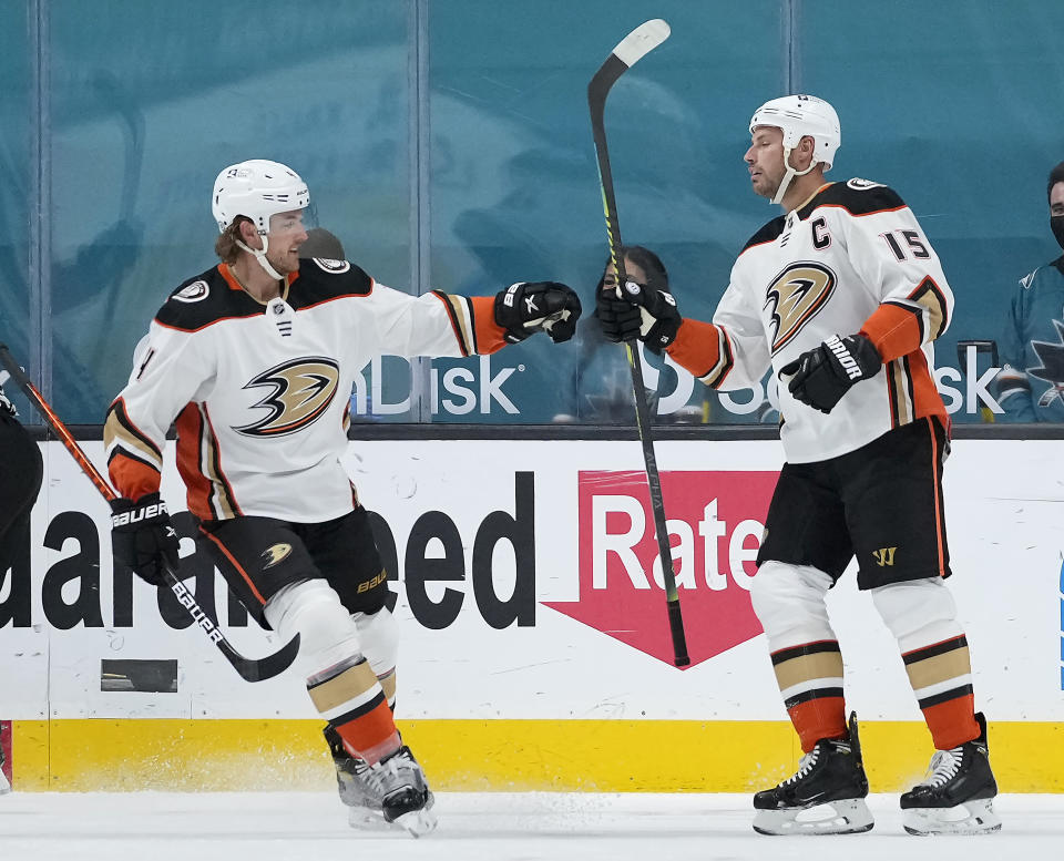 Anaheim Ducks center Ryan Getzlaf (15) is congratulated by Cam Fowler (4) after scoring a goal against the San Jose Sharks during the first period of an NHL hockey game Wednesday, April 14, 2021, in San Jose, Calif. (AP Photo/Tony Avelar)