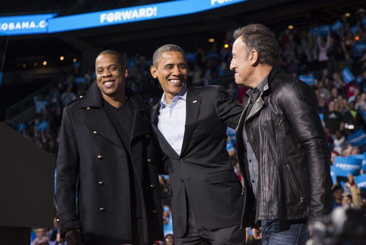 U.S. President Barack Obama stands on stage with rapper Jay-Z and musician Bruce Springsteen