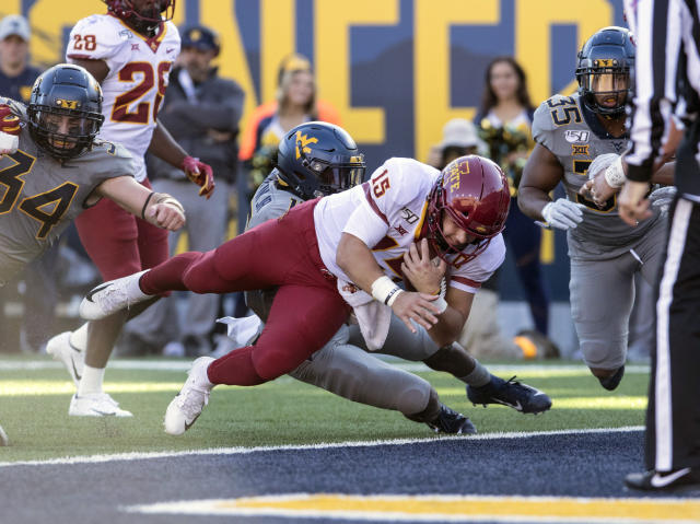 Iowa State quarterback Brock Purdy (15) runs for a touchdown during the first half of an NCAA college football game Saturday against West Virginia, in Morgantown, W.Va. (AP Photo/Raymond Thompson)