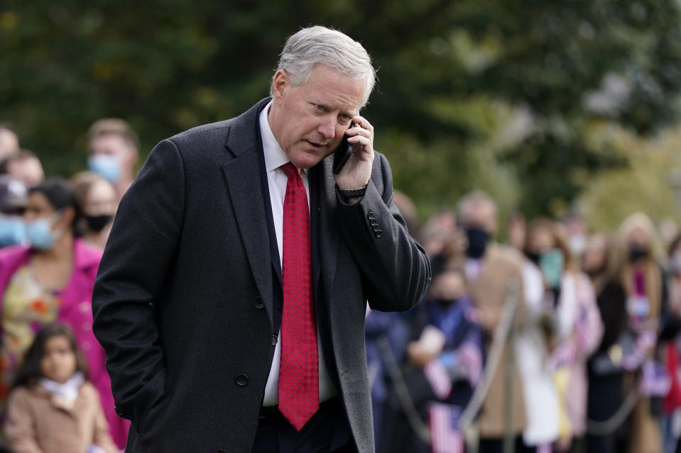 In this Oct. 30, 2020, photo, White House chief of staff Mark Meadows speaks on a phone on the South Lawn of the White House in Washington. Meadows has been diagnosed with the coronavirus as the nation sets daily records for confirmed cases for the pandemic. (AP Photo/Patrick Semansky)