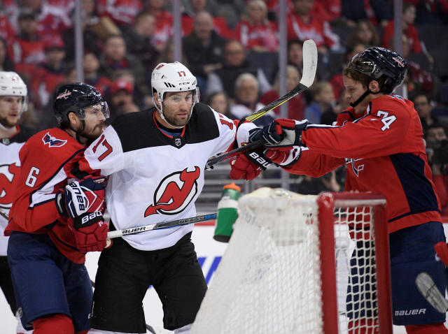New Jersey Devils left wing Patrick Maroon (17) scuffles with Washington Capitals defenseman Michal Kempny (6) and defenseman John Carlson (74) during the first period of an NHL hockey game Saturday, April 7, 2018, in Washington. (AP Photo/Nick Wass)