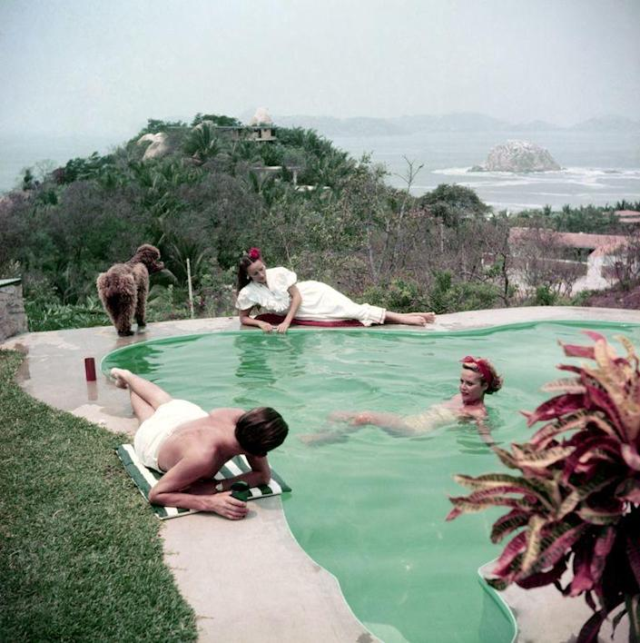 <p>Actress Dolores del Río lounges by a pool with friends while in Acapulco in 1952. </p>