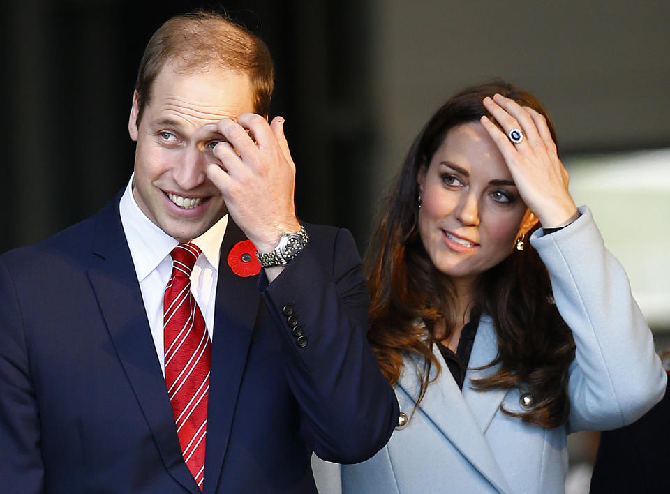 Britain's Catherine, Duchess of Cambridge (R) and her husband Prince William exit a fire station during a visit to the Valero Pembroke Refinery in south Wales, November 8, 2014. REUTERS/Darren Staples   (BRITAIN - Tags: ROYALS)