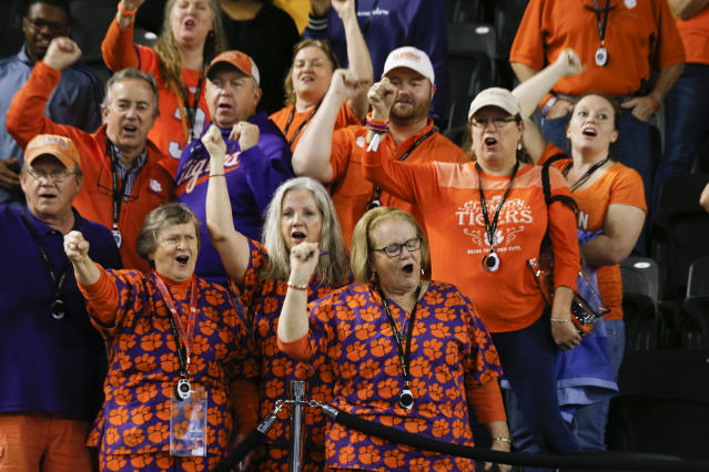 Clemson fans cheers during media day for NCAA College Football Playoff national championship game Saturday, Jan. 11, 2020, in New Orleans. Clemson is scheduled to play LSU on Monday. (AP Photo/Gerald Herbert)