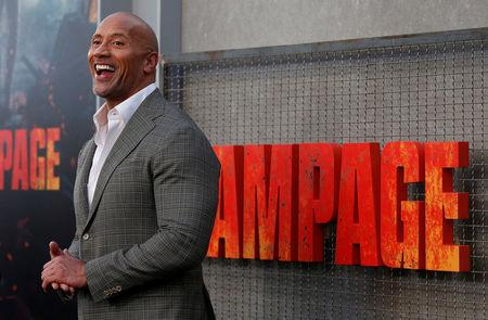 """Cast member Dwayne Johnson poses at the premiere for the movie """"Rampage"""" in Los Angeles, California, U.S., April 4, 2018. REUTERS/Mario Anzuoni"""