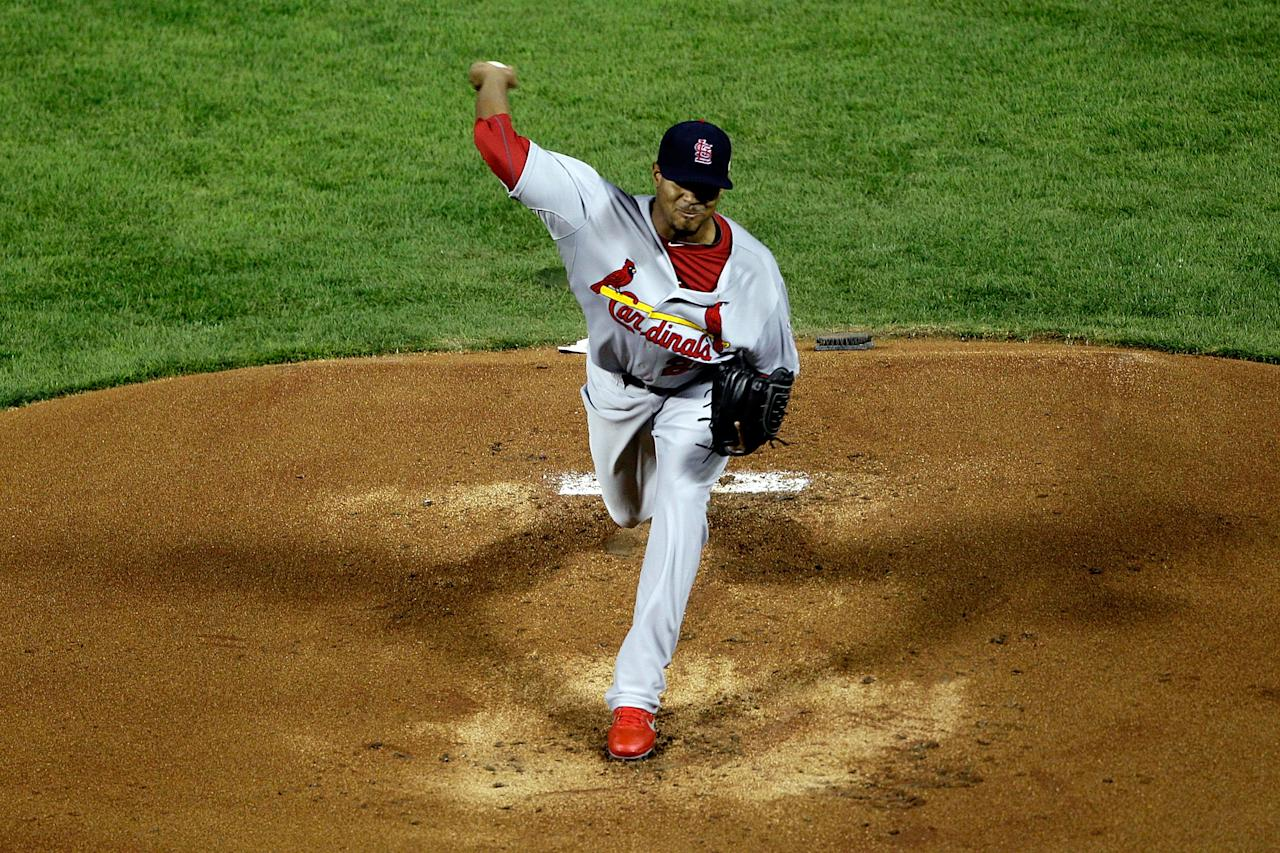 ARLINGTON, TX - OCTOBER 23:  Edwin Jackson #22 of the St. Louis Cardinals pitches in the first inning during Game Four of the MLB World Series against the Texas Rangers at Rangers Ballpark in Arlington on October 23, 2011 in Arlington, Texas.  (Photo by Rob Carr/Getty Images)