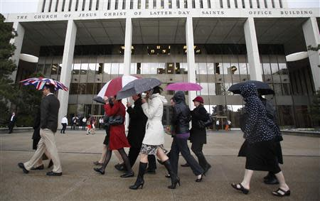 A group of Mormon women walk to Temple Square in an attempt to get tickets to the priesthood meeting at The Church of Jesus Christ of Latter-day Saints semi-annual gathering known as general conference in Salt Lake City, Utah April 5, 2014. REUTERS/Jim Urquhart