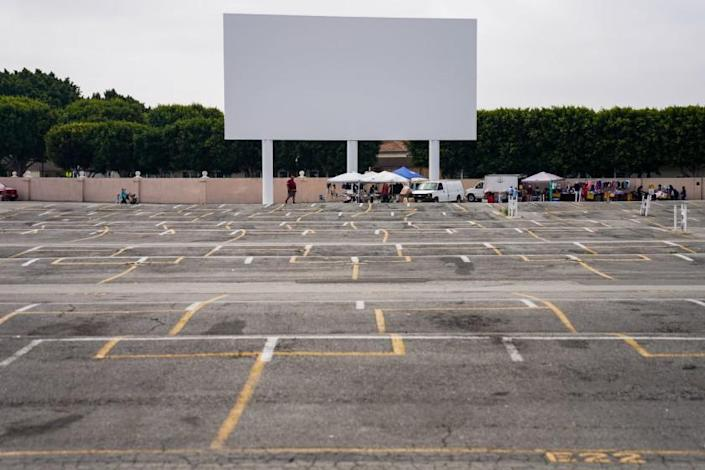 "Normally packed with vendors and shoppers, the vast lot near the drive-in screen at the Paramount Swap Meet is mostly empty on a recent Saturday. <span class=""copyright"">(Kent Nishimura / Los Angeles Times)</span>"