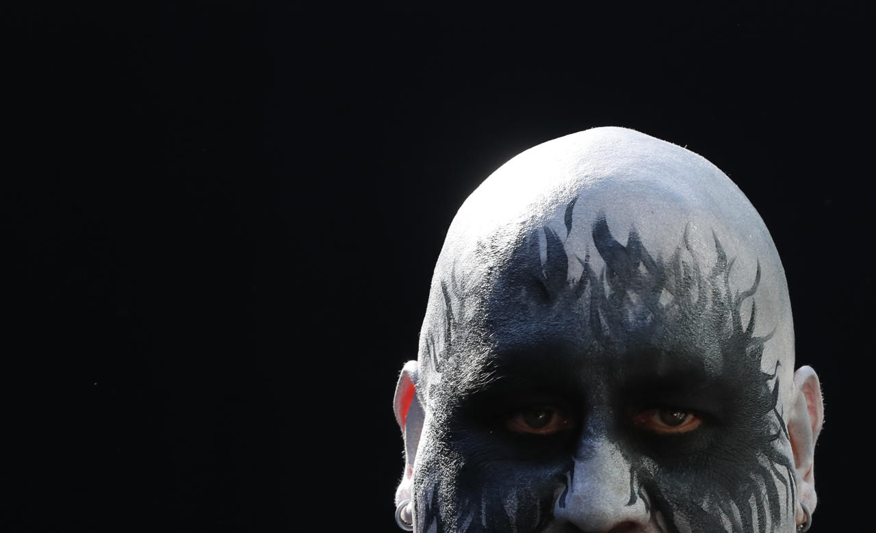 <p>A man with a decorated face looks on during The International Tattoo Convention in London, Friday, Sept. 22, 2017. (Photo: Kirsty Wigglesworth/AP) </p>