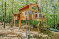 """<p>While only 350 square feet, this eco-friendly tiny home among the trees in Sanford, Maine has everything you need for a relaxing stay. There's a full kitchen equipped with cookware, essential appliances, and more. The loft and attached sleeping pod both feature queen size beds. Not to mention, there are pristine views of trees that the owner describes as """"green glass [that filters] the early morning light.""""</p><p><a class=""""link rapid-noclick-resp"""" href=""""https://www.airbnb.com/rooms/41341525"""" rel=""""nofollow noopener"""" target=""""_blank"""" data-ylk=""""slk:BOOK NOW"""">BOOK NOW</a> <strong><em>Canopy Treehouse</em></strong></p>"""