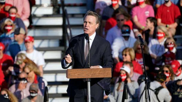 PHOTO: Sen. David Perdue, R-Ga., speaks during a campaign rally for President Donald Trump at Middle Georgia Regional Airport, Friday, Oct. 16, 2020, in Macon, Ga. (John Bazemore/AP)