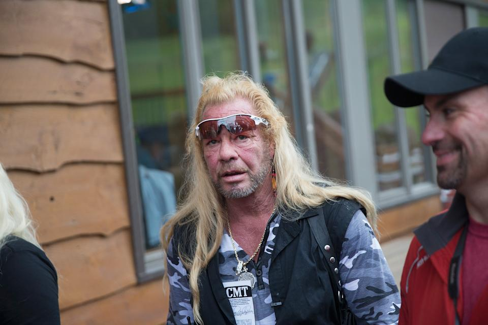 MALONE, NY - JUNE 28:   Dog the Bounty Hunter, Duane Chapman films a segment of his television show outside of a news conference where  New York Gov. Andrew Cuomo was speaking to the media about the capture of convicted murderer David Sweat on June 28, 2015 in Malone, New York. Sweat was shot by a State Police officer and taken into custody in Constable, New York, north of Malone and near the Canadian border. On Friday Richard Matt, who escaped with Sweat, was shot and killed in the same area. More than 1,000 State Police, Border Patrol, correction officers, FBI and other law enforcement agencies have been searching for the pair since they were discovered missing from a prison in nearby Dannemora on June 6.  (Photo by Scott Olson/Getty Images)