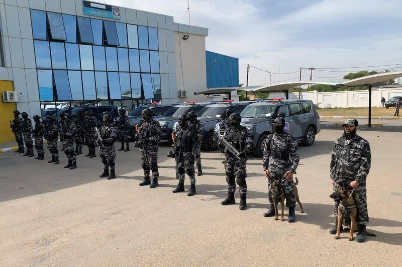 Security forces stand as they prepare for a training in Tripoli
