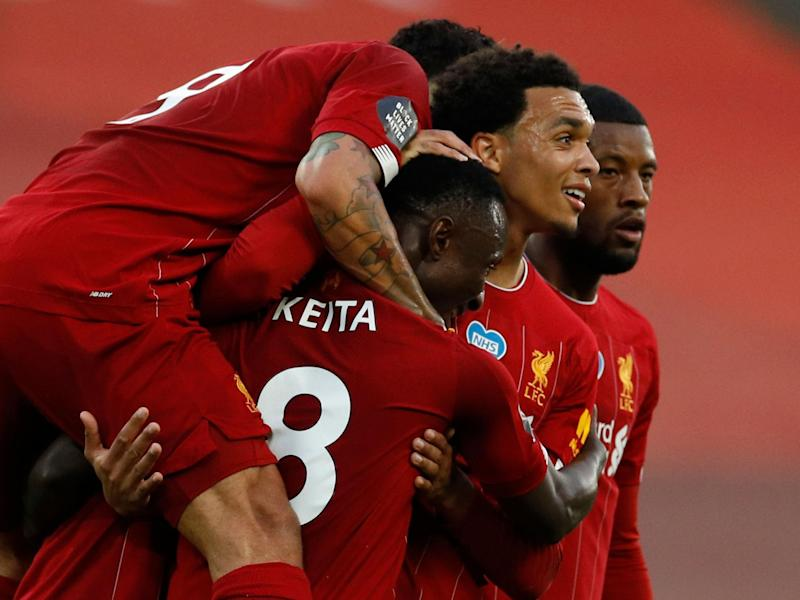 Liverpool celebrate after Keita opens the scoring: POOL/AFP