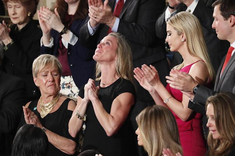 "Carryn Owens, widow of widow of Chief Special Warfare Operator William ""Ryan"" Owens, is applauded on Capitol Hill in Washington, Tuesday, Feb. 28, 2017, as she was acknowledged by President Donald Trump during his address to a joint session of Congress. (AP Photo/Pablo Martinez Monsivais)"