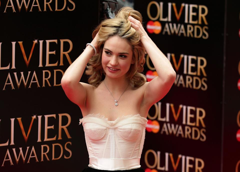 Lily James arrives at the Olivier Awards 2013, at the Royal Opera House, in Covent Garden, central London.