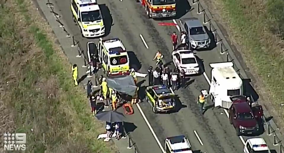 Paramedics and police officers at the scene in Queensland's southeast.