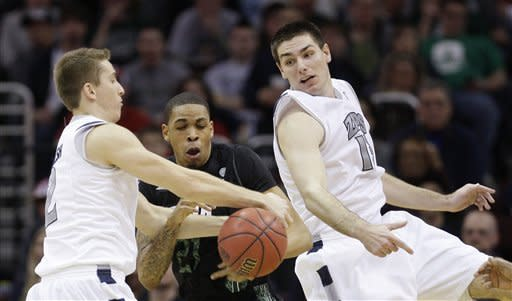 Ohio's Jon Smith, center, and Akron's Brian Walsh, left, and Akron's Nikola Cvetinovic battle for the ball during the first half of an NCAA college basketball championship game in the Mid-American Conference men's tournament Saturday, March 10, 2012, in Cleveland. (AP Photo/Tony Dejak)