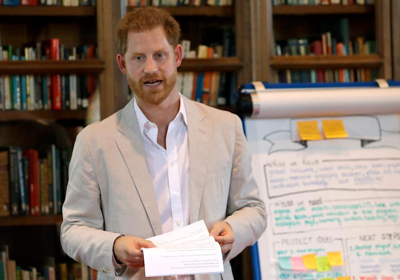 Prince Harry speaks to participants at Dr Jane Goodall's Roots & Shoots global leadership meeting at St. George's House, Windsor Castle, July 23, 2019.