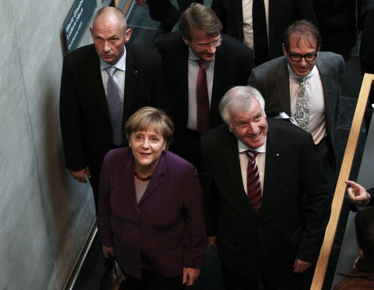 German Chancellor and leader of the Christian Democratic Union (CDU) Angela Merkel and leader of the Christian Social Union party (CSU) Horst Seehofer arrive for preliminary coalition talks between Germany's conservative (CDU/CSU) parties and the environmental Greens party (Die Gruenen) at the Parliamentary Society in Berlin October 10, 2013. REUTERS/Tobias Schwarz (GERMANY - Tags: POLITICS)