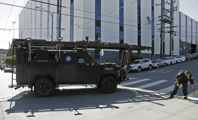 <p>A San Francisco police armored vehicle arrives outside a UPS package delivery warehouse where a shooting took place Wednesday, June 14, 2017, in San Francisco. A UPS spokesman says four people were injured in the shooting at the facility and that the shooter was an employee. (AP Photo/Eric Risberg) </p>