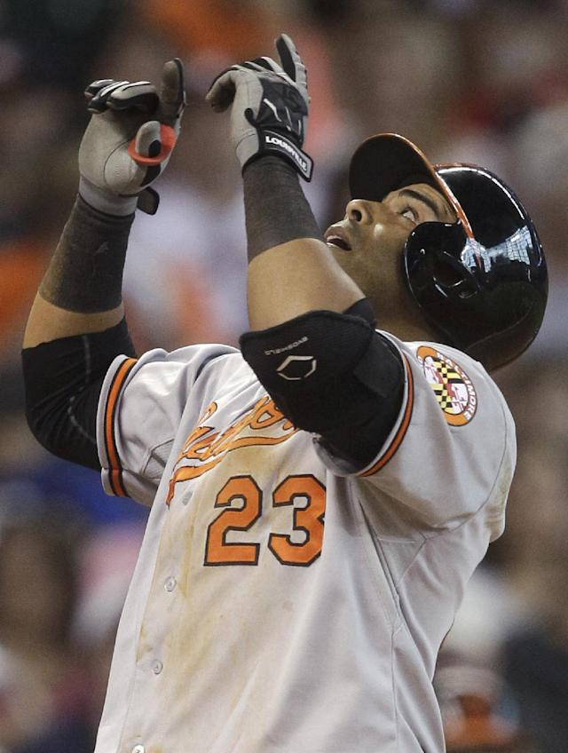 Baltimore Orioles' Nelson Cruz points to the sky after hitting a solo home run during the eighth inning of a baseball game against the Houston Astros, Saturday, May 31, 2014, in Houston. (AP Photo/Patric Schneider)