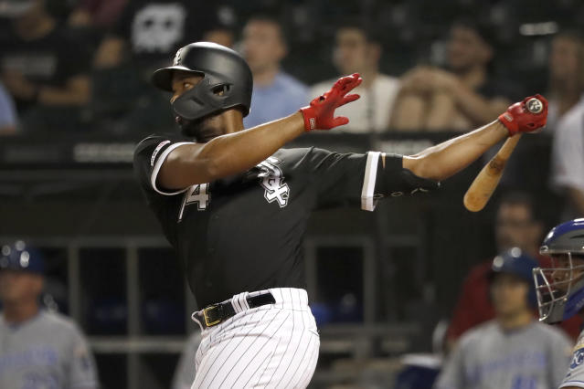 Chicago White Sox's Eloy Jimenez watches his grand slam off Kansas City Royals starting pitcher Jakob Junis during the first inning of a baseball game Tuesday, Sept. 10, 2019, in Chicago. (AP Photo/Charles Rex Arbogast)