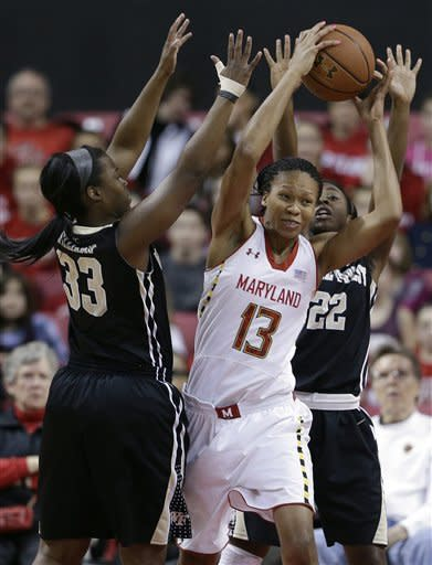 Maryland center Alicia DeVaughn (13) drives to the basket between Wake Forest guards Asia Williams, left, and Lakevia Boykin in the first half of an NCAA college basketball game in College Park, Md., Sunday, March 3, 2013. (AP Photo/Patrick Semansky)