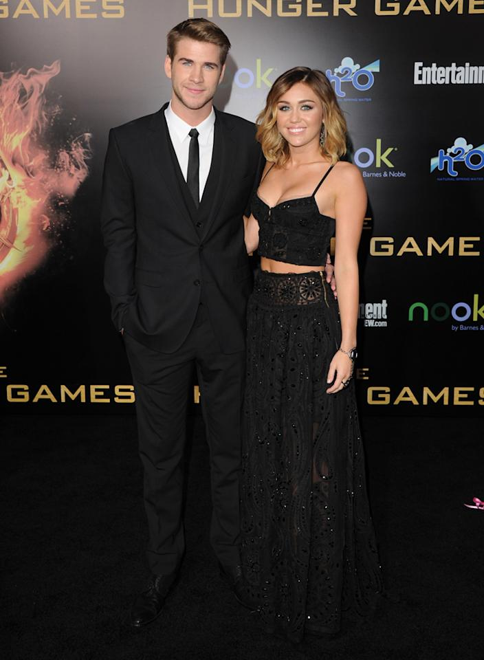 "Liam Hemsworth and Miley Cyrus arrive at the world premiere of ""The Hunger Games"" in Los Angeles, California."