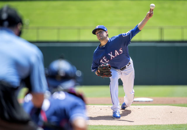 Texas Rangers starting pitcher Joe Palumbo works against the Los Angeles Angels during the first inning of the first baseball game of a doubleheader Tuesday, Aug. 20, 2019, in Arlington, Texas. (AP Photo/Jeffrey McWhorter)