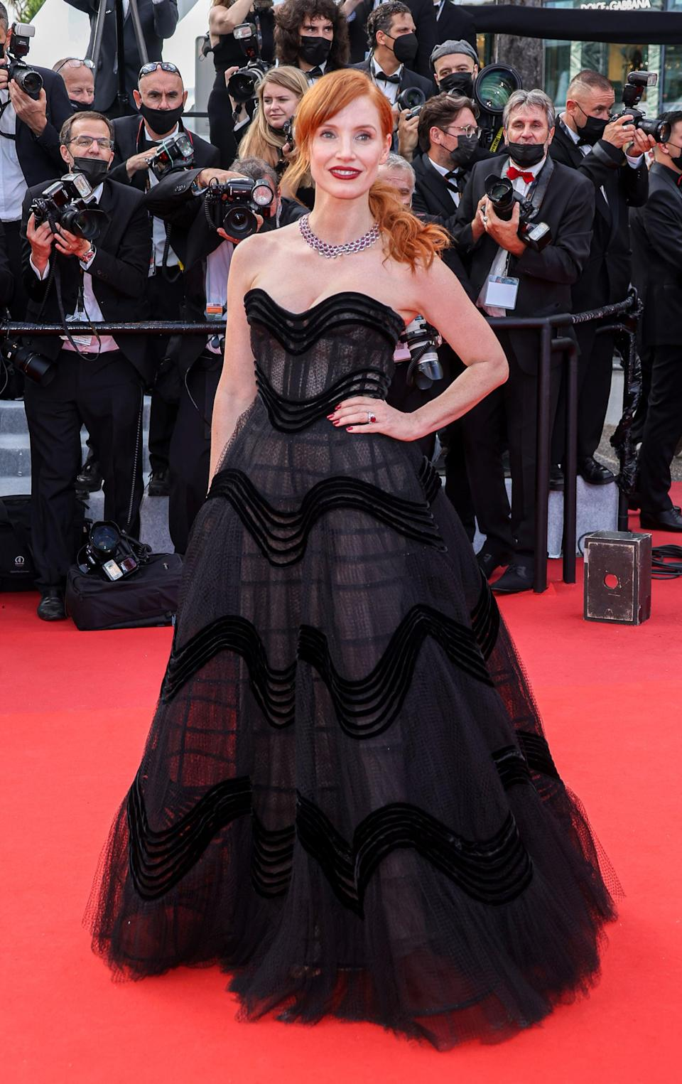<p>Wearing a Christian Dior Haute Couture gown with nearly 200 carats worth of Chopard rubies.</p>