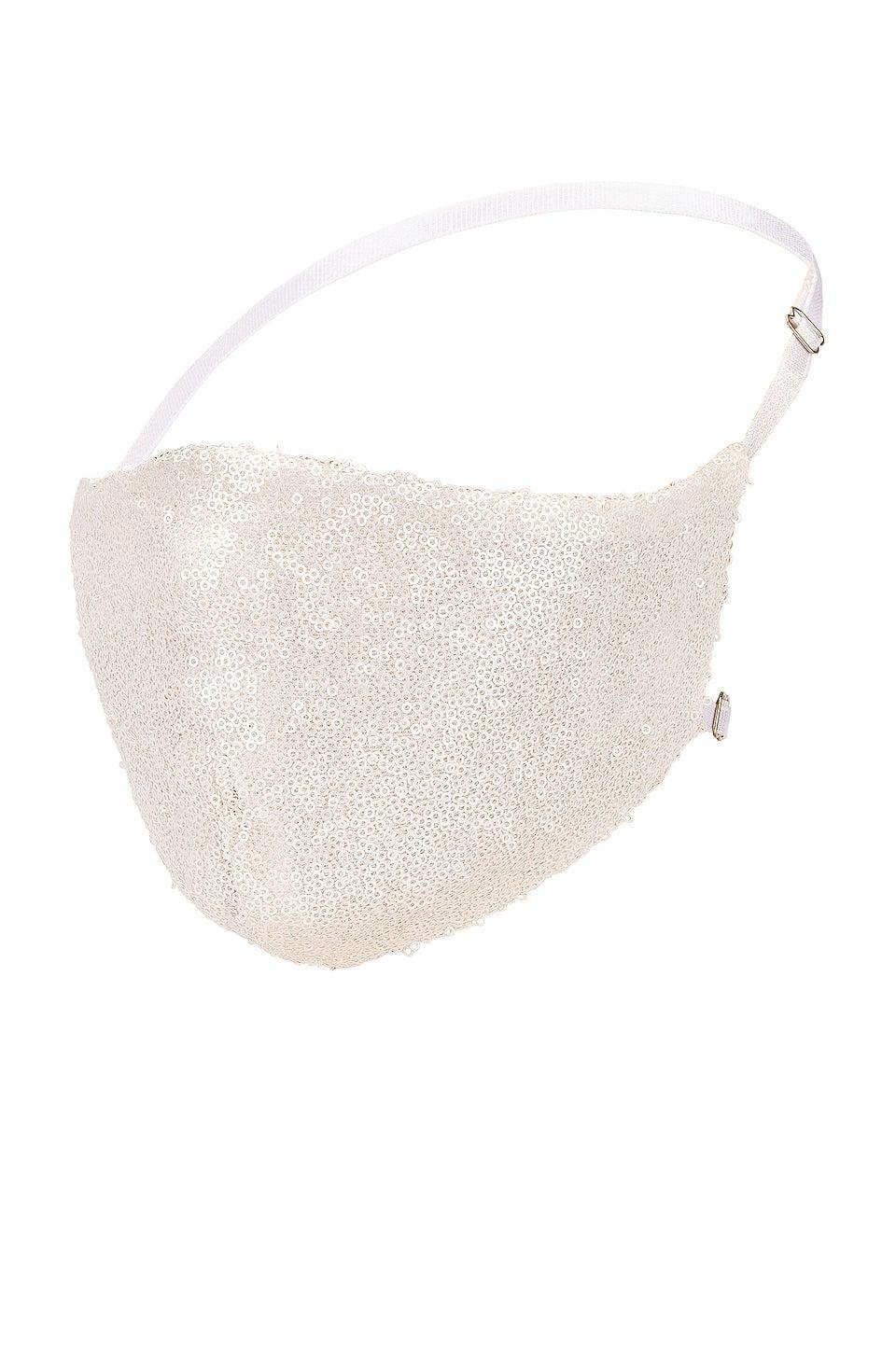 """<br><br><strong>Katie May</strong> Disco Ball Face Mask, $, available at <a href=""""https://go.skimresources.com/?id=30283X879131&url=https%3A%2F%2Fwww.revolve.com%2Fkatie-may-disco-ball-face-mask%2Fdp%2FKATR-WA2%2F"""" rel=""""nofollow noopener"""" target=""""_blank"""" data-ylk=""""slk:Revolve"""" class=""""link rapid-noclick-resp"""">Revolve</a>"""