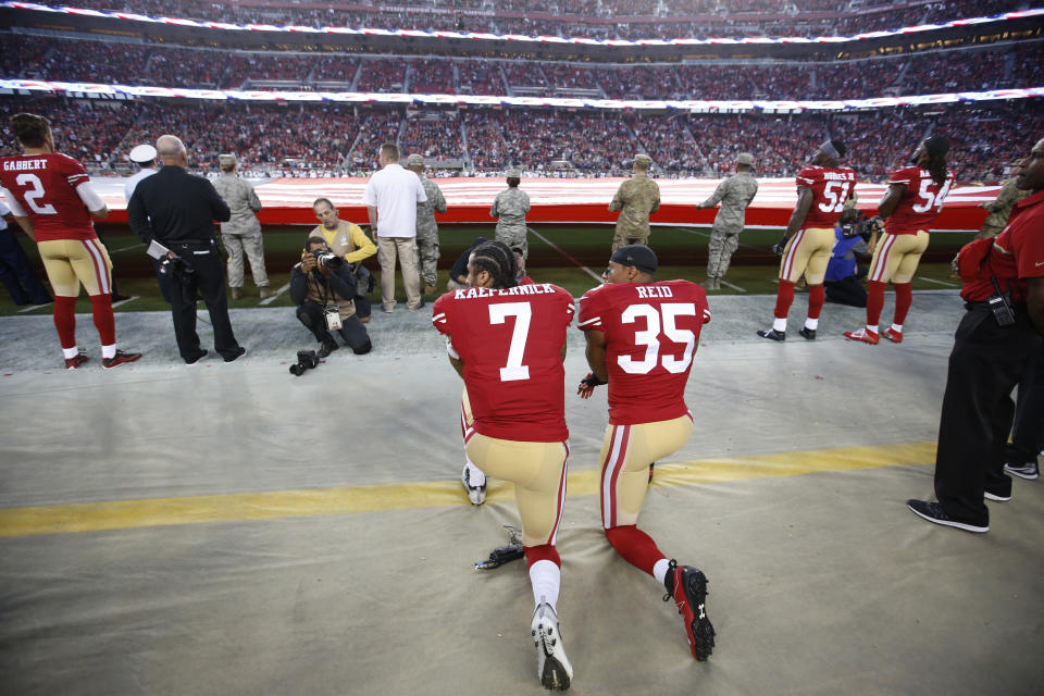 SANTA CLARA, CA - SEPTEMBER 12: Eric Reid #35 and Colin Kaepernick #7 of the San Francisco 49ers kneel during the anthem prior to the game against the Los Angeles Rams at Levi Stadium on September 12, 2016 in Santa Clara, California. The 49ers defeated the Rams 28-0. (Photo by Michael Zagaris/San Francisco 49ers/Getty Images)  *** Local Caption ***