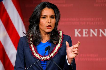 FILE PHOTO: U.S. Representative Tulsi Gabbard (D-HI) speaks after being awarded a Frontier Award during a ceremony at the Kennedy School of Government at Harvard University in Cambridge, Massachusetts November 25, 2013. REUTERS/Brian Snyder/File Photo