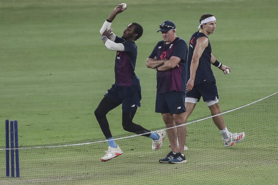 England team's head coach Chris Silverwood watches Jofra Archer bowl at the nets as Tom Curran, right, walks past during a training session ahead of the first Twenty20 cricket match between India and England in Ahmedabad, India, Wednesday, March 10, 2021. (AP Photo/Aijaz Rahi)