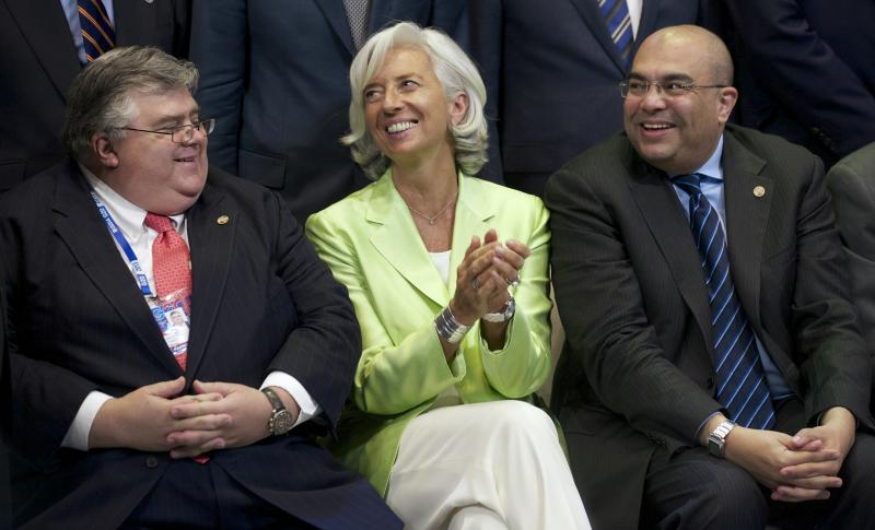 From left, Mexico's Central Bank Governor Agustin Carstens, Managing Director of the International Monetary Fund Christine Lagarde, and Special Envoy for the President of the World Bank Mahmoud Mohieldin pose for a group photo after a meeting of the Group of 20 finance ministers in Moscow, Russia, Saturday, July 20, 2013. The finance chiefs of the world's leading economies hope to force multinational companies to pay more taxes by closing loopholes that have allowed them to stash profits overseas. (AP Photo/Alexander Zemlianichenko)